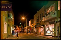 Street with galleries, people walking, and cathedral by night. Santa Fe, New Mexico, USA