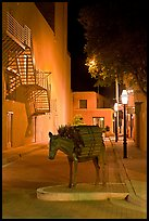 Street with sculpture by night. Santa Fe, New Mexico, USA