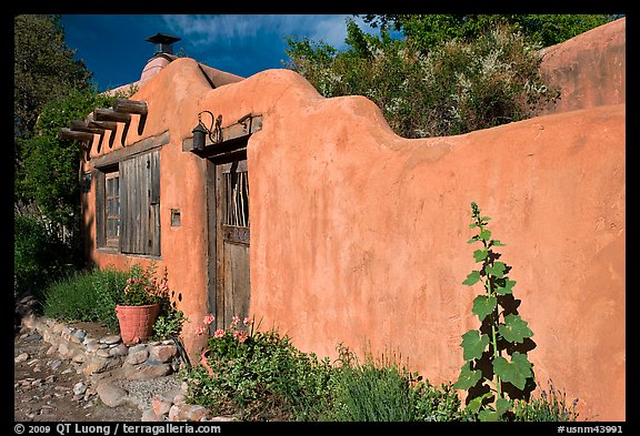 Adobe wall and weathered wooden door and window. Santa Fe, New Mexico, USA (color)