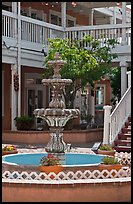 Fountain and white guardrails, old town. Albuquerque, New Mexico, USA (color)