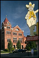 Giant Cactus Jack sign and brick building. Carson City, Nevada, USA (color)