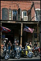 Motorcycles parked in front of brick historic building. Virginia City, Nevada, USA (color)