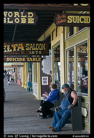 Arcade with suicide table sign. Virginia City, Nevada, USA (color)