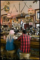 Man and woman sitting in saloon. Virginia City, Nevada, USA (color)