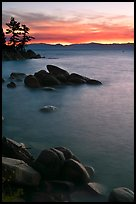 Sunset over lake with boulders, Sand Harbor, East Shore, Lake Tahoe, Nevada. USA