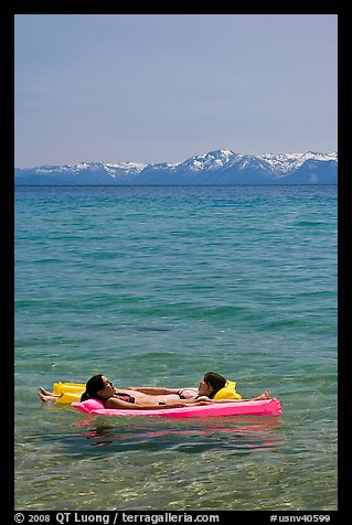 Girls laying on floating mattress, Sand Harbor, East Shore, Lake Tahoe, Nevada. USA (color)