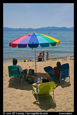 Beach unbrella and family, Sand Harbor, Lake Tahoe-Nevada State Park, Nevada. USA (color)