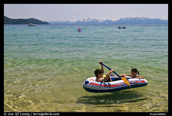 Children playing in inflatable boat, Sand Harbor, Lake Tahoe-Nevada State Park, Nevada. USA (color)