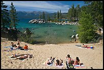 Young people sunbathing on sandy beach, Sand Harbor, Lake Tahoe, Nevada. USA (color)