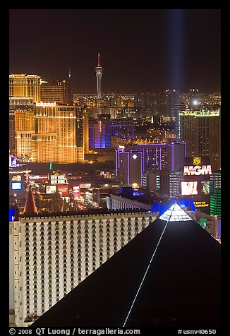Luxor pyramid, casinos, and Stratosphere tower at night. Las Vegas, Nevada, USA