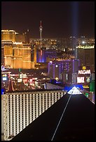 Luxor pyramid, casinos, and Stratosphere tower at night. Las Vegas, Nevada, USA ( color)