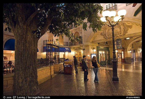 Man and woman standing on plaza inside Paris casino. Las Vegas, Nevada, USA (color)