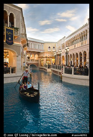 Gondolier singing song to couple during ride inside Venetian casino. Las Vegas, Nevada, USA (color)