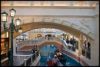 Gondolas passing below bridge, inside Venetian hotel. Las Vegas, Nevada, USA (color)