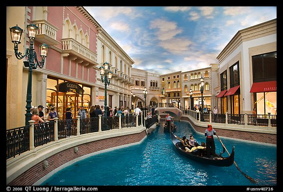 Gondolas and Grand Canal bordered by shops in the Venetian casino. Las Vegas, Nevada, USA (color)