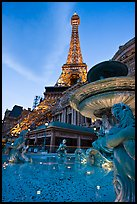 Fountain and Eiffel Tower replica at dusk, Paris casino. Las Vegas, Nevada, USA ( color)