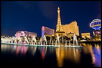 Paris casino and Bellagio fountains by night. Las Vegas, Nevada, USA