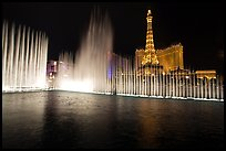 Bellagio fountains and Paris hotel by night. Las Vegas, Nevada, USA
