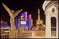 Gazebo and statue of Caesar Palace frames Ballys and Paris Hotel. Las Vegas, Nevada, USA
