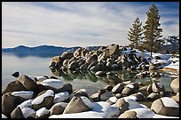Snow and boulders on shore, Sand Harbor, Lake Tahoe-Nevada State Park, Nevada. USA