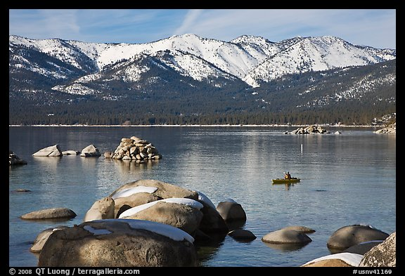 Boulders, kayak, and snowy mountains, Sand Harbor, Lake Tahoe-Nevada State Park, Nevada. USA (color)