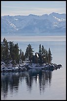 Cabin on lakeshore and snowy mountains, Lake Tahoe, Nevada. USA