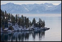 Lakeshore with houses and snow-covered mountains, Lake Tahoe, Nevada. USA