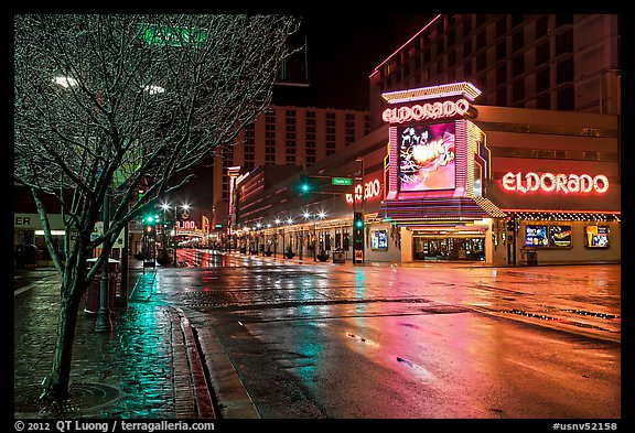 Main street with night reflections on wet pavement. Reno, Nevada, USA (color)