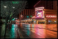 Main street with night reflections on wet pavement. Reno, Nevada, USA ( color)