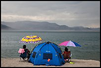 People with tent and beach umbrellas, approaching storm. Pyramid Lake, Nevada, USA ( color)