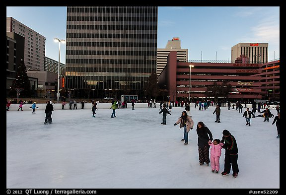 Skaters on holiday ice rink. Reno, Nevada, USA (color)