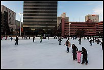 Skaters on holiday ice rink. Reno, Nevada, USA ( color)