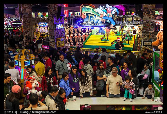 Families crowd arcade during holidays. Reno, Nevada, USA (color)