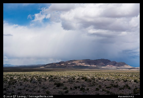 Wide valley, distant mountains, and clouds. Basin And Range National Monument, Nevada, USA (color)