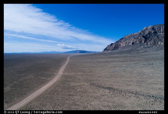Aerial view of road through wide valley. Basin And Range National Monument, Nevada, USA (color)