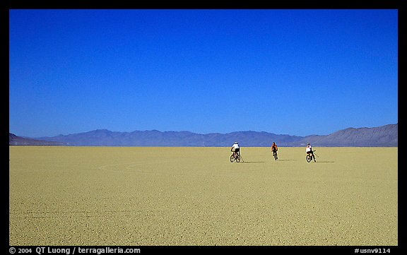 Three bicyclists on the desert Playa, Black Rock Desert. Nevada, USA (color)
