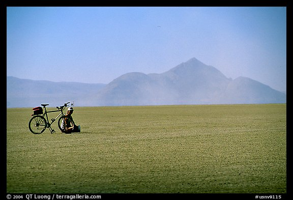Bicyclist on the desert Playa, Black Rock Desert. Nevada, USA (color)