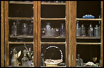 Old bottles in a store window, Austin. Nevada, USA (color)