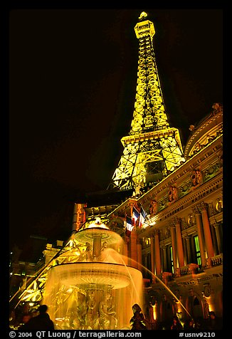 Fountain, opera house and Eiffel tower, Paris Las Vegas by night. Las Vegas, Nevada, USA