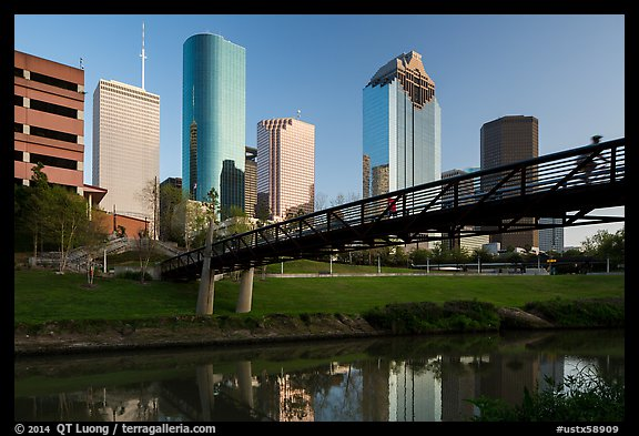 Bridge with bicyclist, reflection, and skyline. Houston, Texas, USA (color)