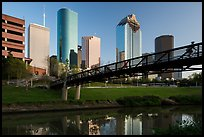 Bridge with bicyclist, reflection, and skyline. Houston, Texas, USA ( color)