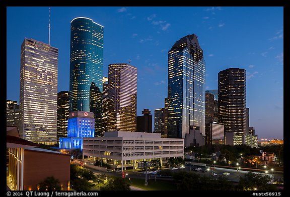 Skyline with lights at dusk. Houston, Texas, USA (color)