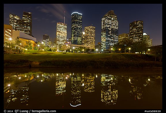 Dowtown skyline and reflection at night. Houston, Texas, USA (color)