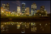 Dowtown skyline and reflection at night. Houston, Texas, USA ( color)