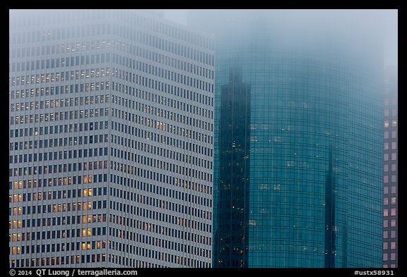 Top of high-rise buildings capped by fog. Houston, Texas, USA (color)