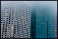 Top of high-rise buildings capped by fog. Houston, Texas, USA ( color)