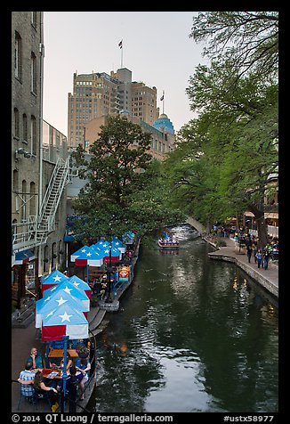 Riverwalk promenade, approaching barge. San Antonio, Texas, USA (color)