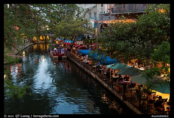 Restaurant tables and barge, Riverwalk. San Antonio, Texas, USA (color)