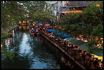 Restaurant tables and barge, Riverwalk. San Antonio, Texas, USA ( color)
