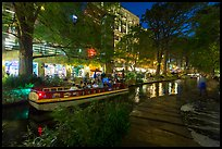 Barge and walkway at dusk, Riverwalk. San Antonio, Texas, USA ( color)